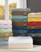 Indulge in the plush softness of pure combed cotton from Belgium, offering superior absorbency, a wide honeycomb dobby and rich, long-lasting color.59L X 28W Cotton Machine wash Imported