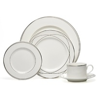 Vows dinnerware collection by Lauren Ralph Lauren Home. Inspired by the graceful curves of wedding rings, this elegant dinnerware line features interconnected platinum bands on the finest bone china. Makes a stunning table for any special occasion. Set includes dinner plate, salad plate, bread & butter plate, teacup and saucer.