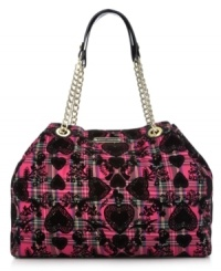 Bold, bright and unquestionably eye-catching, this take-anywhere tote from Betsey Johnson adds interest to everyday accessorizing. Golden chain-link straps and signature hadrware play up the pretty pattern, while the spacious interior holds all your daily essentials without a worry.