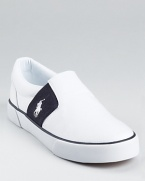 A stylish, sleek summertime option, this handsome slip on from Ralph Lauren Childrenswear is crafted in canvas with a matching rubber sole and contrasting panels at the sides.