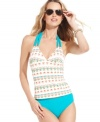 Soak in the sun with Anne Cole's chic halter tankini top featuring a fun print fit for the beach!