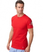A classic crew neck short-sleeved T-shirt is constructed for lightweight comfort in soft combed cotton jersey.