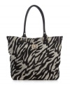 AK Anne Klein goes wild with a zebra stripe to dress up the basic tote purse this season.