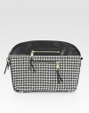 Graphic houndstooth fabric with leather trim and goldtone hardware.Top zip closureProtective metal feetTwo outside zip pocketsTwo inside open pocketsCotton lining14½W X 10½H X 3¼DMade in Italy