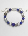 From the Spiritual Bead Collection. A beautiful beaded style with lapis labordarite and freshwater pearls on a sterling silver box chain. Lapis, labordarite and freshwater pearlsSterling silverDiameter, about 2 adjustableBeaded closureImported