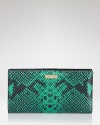 This kate spade new york wallet flaunts a perfect mix of style and substance, crafted of snake embossed leather. It's a wildly exotic essential.
