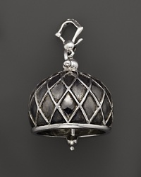 Inspired by Zen philosophy, this intricately detailed, blackened and polished sterling silver meditation bell from Paul Morelli jingles softly.