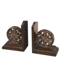 Keep your wheels turning. Chakra bookends by Uttermost feature a distressed chestnut-brown finish and tan glaze to organize your personal library with rustic sophistication.