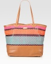 A roomy carryall with a brightly colored woven pattern in luxurious leather.Double shoulder strap, 10 dropOpen topProtective metal feetThree inner compartmentsOne inside zip pocketTwo inside open pocketsCotton lining18¼W X 13H X 6½DImported