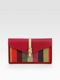 Colorful striped jacquard canvas defines this sleek flap-top silhouette with rich Italian leather accents. Magnetic snap flap closureOne outside zip pocketOne inside open pocketOne inner zip compartmentEight credit card slotsSuede, leather and cotton lining9¾W X 6H X 1DMade in Italy