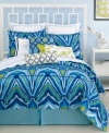 Taking inspiration from the regal peacock, this duvet cover set from Trina Turk features an abstract peacock feather design. Vibrant blue and green tones complete this bold, ultra-modern look. Button closure.