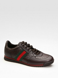 Lace-up sneaker in micro guccissima and smooth leathers with signature green/red/green web. Rubber sole Made in Italy