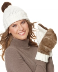 Cozy comfort topped off by frisky faux fur. Beat the chill in fashion with this knit cap by Style&co.