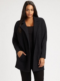 Whether worn over a sleek or relaxed-fit top, this boiled merino wool coat is sure to make a stylish first impression. Notched collarDolman sleevesWelt pocketsAbout 32 from shoulder to hemBody: merino woolSleeves: merino wool/nylon/spandexDry cleanImported