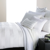 Effortless elegance. A creamy hue and high thread count distinguish this luxurious Donna Karan bedskirt.
