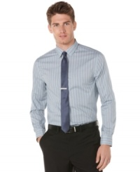 Slim down your business look with this modern trimmed dobby stripe shirt from Perry Ellis. (Clearance)