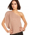 Allover sparkles add shine to this GUESS one-shoulder top that's perfect for soiree style!