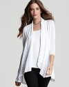 This Catherine Malandrino cardigan boasts an open silhouette and draped collar that infuses your daytime look with relaxed style.