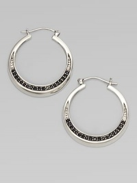 From the Eclipse Collection. Elegant hoops with an arc of faceted deep blue sapphires set in polished sterling silver.Blue sapphireSterling silverDiameter, about 1¾ PiercedImported