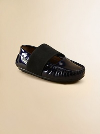 Slip your little one's feet into these comfy moccasins in shiny patent leather with a thick elastic strap for a perfect fit.Slip-on with elastic closureLeather upperLeather liningRubber solePadded insoleImported