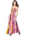 Calvin Klein's striped maxi is on the spring must-have list with its colorful print and chic style.
