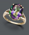 Let a faceted rainbow of color decorate your digits. A large oval-cut mystic topaz gemstone (7-1/6 ct. t.w.) sits in a split band 14k gold setting decorated with two diamond side accents.