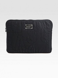 Signature quilted nylon zips around your computer for a stylish cover.Zip-around closureFully lined13¾W X 10½H X 3/4DImported