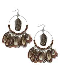 Gypsy inspired. Ali Khan's wood and glass bead earrings (4 mm) combine with brown feathers for an ultra-trendy effect. Set in silver tone mixed metal. Approximate drop: 3-3/4 inches. Approximate diameter: 2 inches.