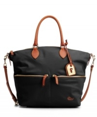 Dooney & Bourke creates the Vanessa bag in sleek colorful nylon with rich leather trim and convertible straps.