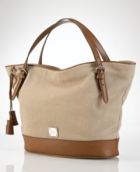 A perfect blend of cool, casual cotton canvas and rich leather accents, this roomy and versatile tote from Lauren by Ralph Lauren is an everyday essential infused with haute style.