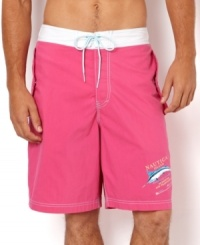 Reel in some serious beach style with these marlin graphic shorts with a bold pop of color from Nautica.