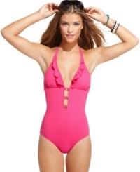 Take a plunge outside of the pool with GUESS?'s one-piece swimsuit. Cutouts and ruffles give it a unique look!