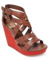 Strappy and gorgeous. DV by Dolce Vita's Tesla platform wedges are made for showing off!