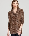 Crisp cheetah print emboldens a decadently draped MICHAEL Michael Kors top for an elegant approach to exotics.