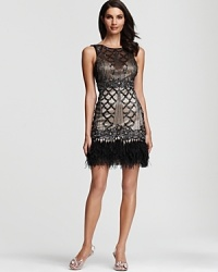 Get noticed in this decadent beaded dress from Sue Wong, accented with airy feathers at the hem.