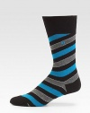 Add a dose of colorful energy to your professional attire with these comfortable, striped cotton-blend socks.Mid-calf height74% cotton/24% polyamide/2% elastaneMachine washImported