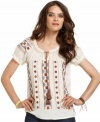 A vintage look for the modern bohemian -- get it with this Lucky Brand Jeans peasant top. Featuring needlepoint embroidery and a chic tassel tie at the neckline, it's all about the details.
