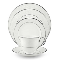 With enameled pearl-like dots, an opalescent background, and the innocence of bone china, Opal Innocence is a romantic pattern of understated elegance. Two bands of platinum a slightly wider one on the rim, kissing a thin fluted design, and a narrower one inside the border adorn each plate. The cup bears additional platinum on its graceful handle and another band at midpoint. Each piece is decorated with a flowing, white-on-white vine design peppered with enamel dots. This service creates a splendid formal table setting and, because of its neutral coloring, works well with any table décor.
