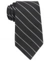 Skinny stripes make a subtle statement that still gets noticed with this DKNY silk tie.