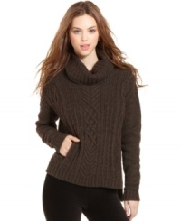 A cold-weather staple, this RACHEL Rachel Roy cable-knit sweater is perfect for a chic casual look!