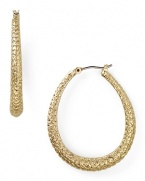 Tap into this season's textured trend with this pair of gold-plated hoop earrings from Carolee, accented by subtle, snakeskin-effect detailing.