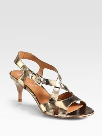 A practical heel lifts this strappy summer essential of lustrous metallic leather. Self-covered heel, 2¾ (70mm)Metallic leather upperAdjustable ankle strapLeather lining and solePadded insoleImportedOUR FIT MODEL RECOMMENDS ordering true size.