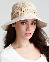 A hand rolled raffia bucket hat with braided detail and a lightweight cotton brim.