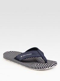 Leather thong sandal with logo detail and striped insole for a sporty feel.Leather upperPadded insoleRubber soleImported