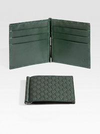 Classic wallet with money clip made of signature microguccisima leather.Six card slotsLeather4W x 4HMade in Italy