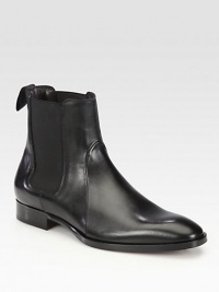 Side elastic gores and minimal detailing shapes and defines this charming chelsea boot constructed in Italy from smooth, supple calfskin leather.Leather upperLeather liningPadded insoleLeather soleMade in Italy