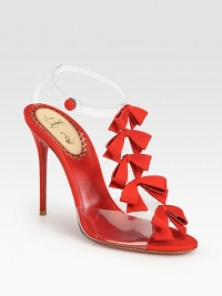 Feminine grosgrain ribbon bows line this t-strap silhouette of translucent PVC, finished with a signature red sole. Grosgrain ribbon-covered heel, 4¼ (110mm)Grosgrain ribbon and PVC upperAnkle strap with snap closureLeather liningSignature red leather solePadded insoleMade in Italy