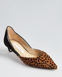 Low-cut sides lend a delicate look to DIANE von FURSTENBERG's Alice pumps, a kitten-heeled silhouette in luxe, dotted haircalf and slick patent leather.
