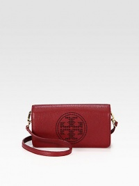 Luxurious pebbled leather with a perforated, signature logo emblem.Detachable adjustable shoulder strap, 20½-22½ dropMagnetic snap flap closureOne inside open pocketCotton lining8W X 4½H X 1½DImported