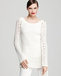 An easy tunic silhouette in an airy open knit ensures you can wear this versatile Donna Karan New York sweater over both casual and dressy looks throughout the year.